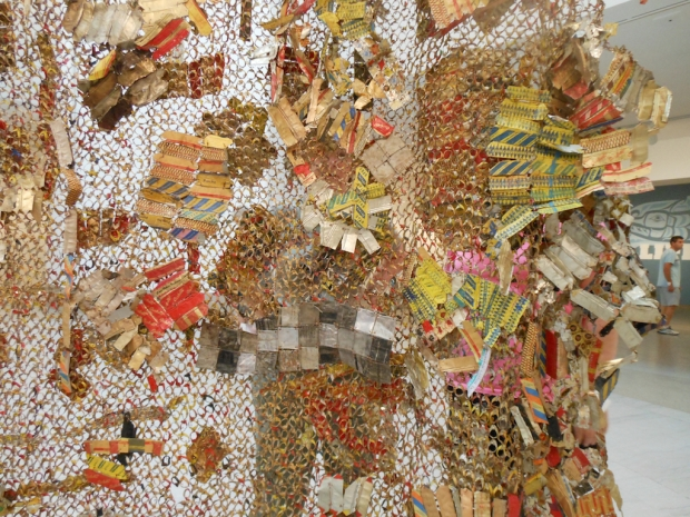"El Anatsui. ""Gli (Wall) (detail),"" 2010. Aluminum and copper wire, installation at the Brooklyn Museum. Photo by Nettrice Gaskins."