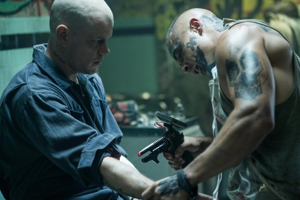 "Jose Pablo Cantillo (right) and Matt Damon in Columbia Pictures' ""Elysium."""