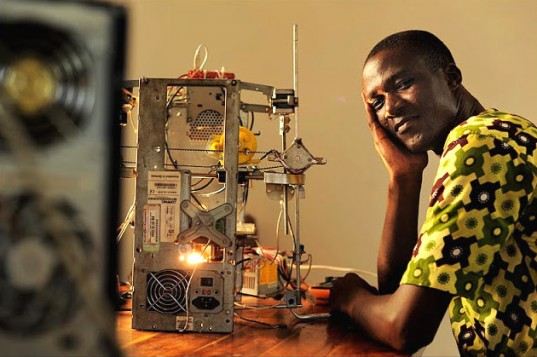 Kodjo Afate Gnikou and his 3D printer. Courtesy inhabitat.com.