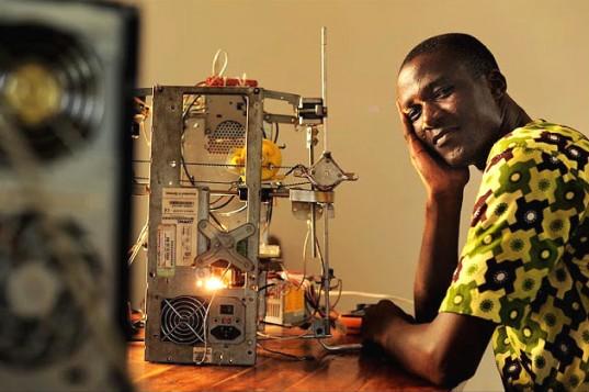 Kodjo Afate Gnikou and his 3D printer. Courtesy inhabitat.com.